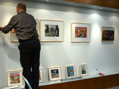 Danke schoen Archim! The embassy's technician installing my work.